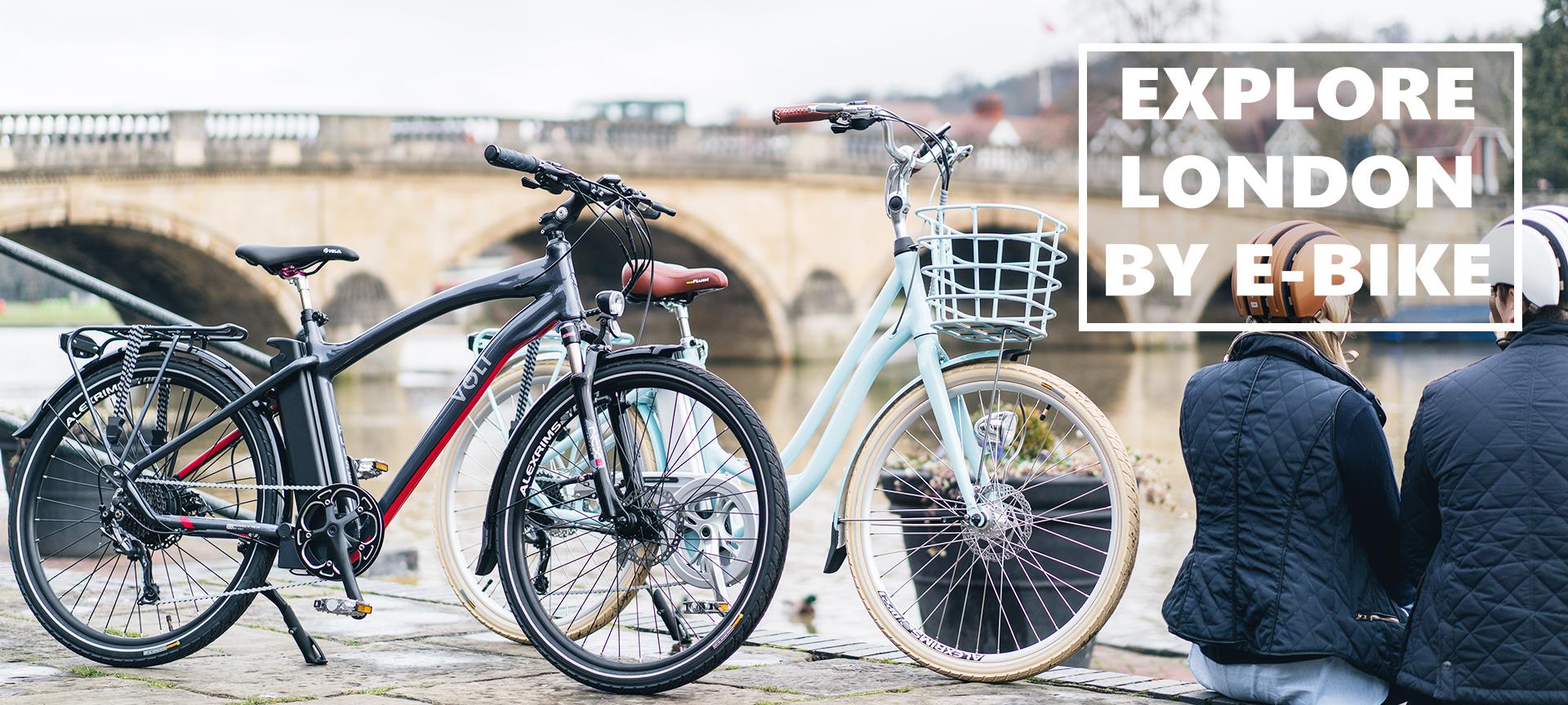 couple-riding-electric-bikes-through-the-suburbs